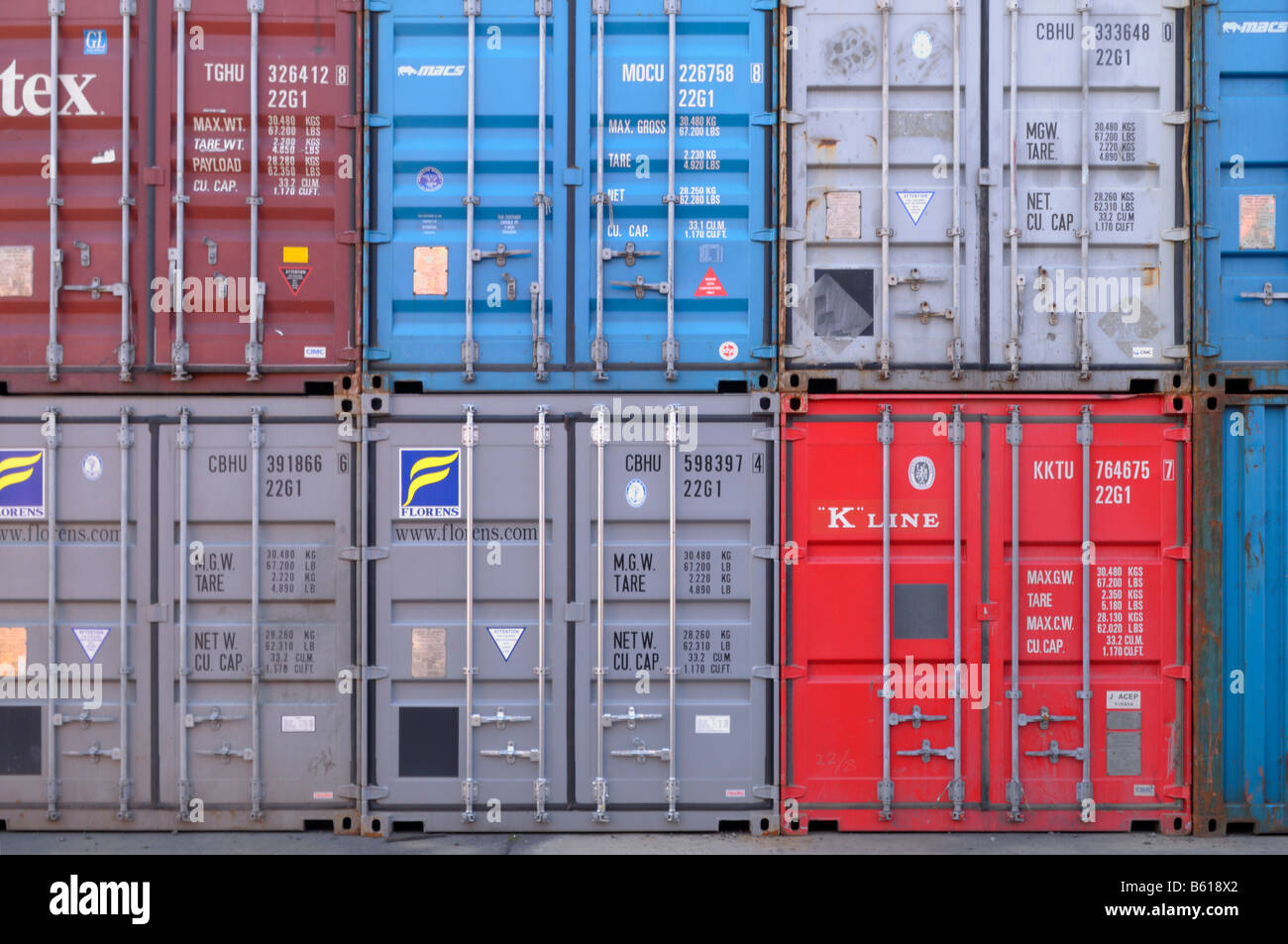 Various stacked overseas containers, format-filling - Stock Image