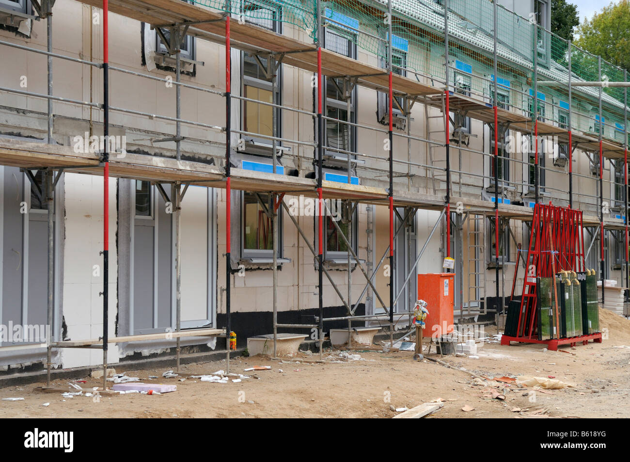 Scaffold, construction site of a terraced, windows already insulated, Bonn, North Rhine-Westphalia Stock Photo