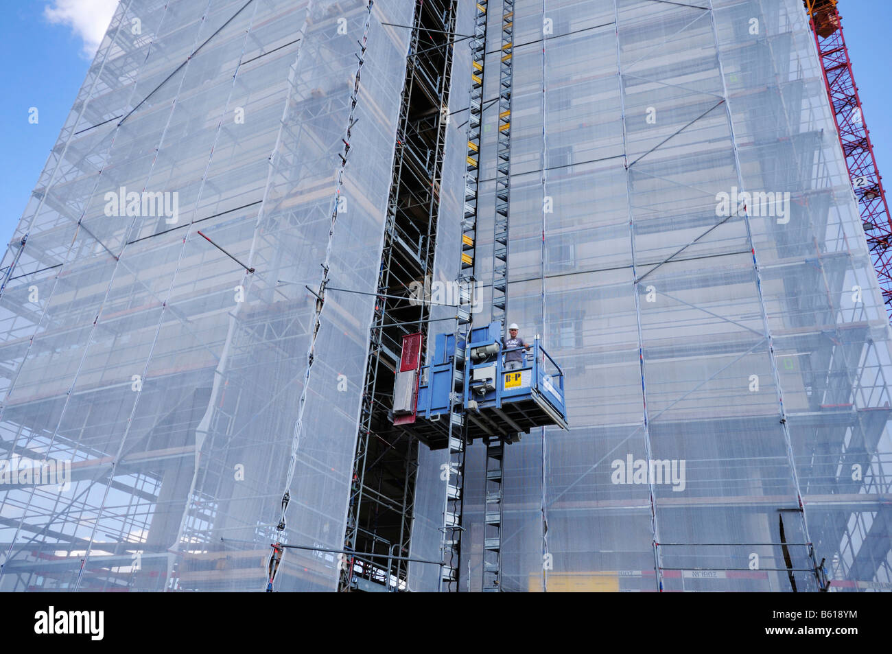 Lift on a construction site, scaffolded World Conference Center in Bonn, North Rhine-Westphalia - Stock Image