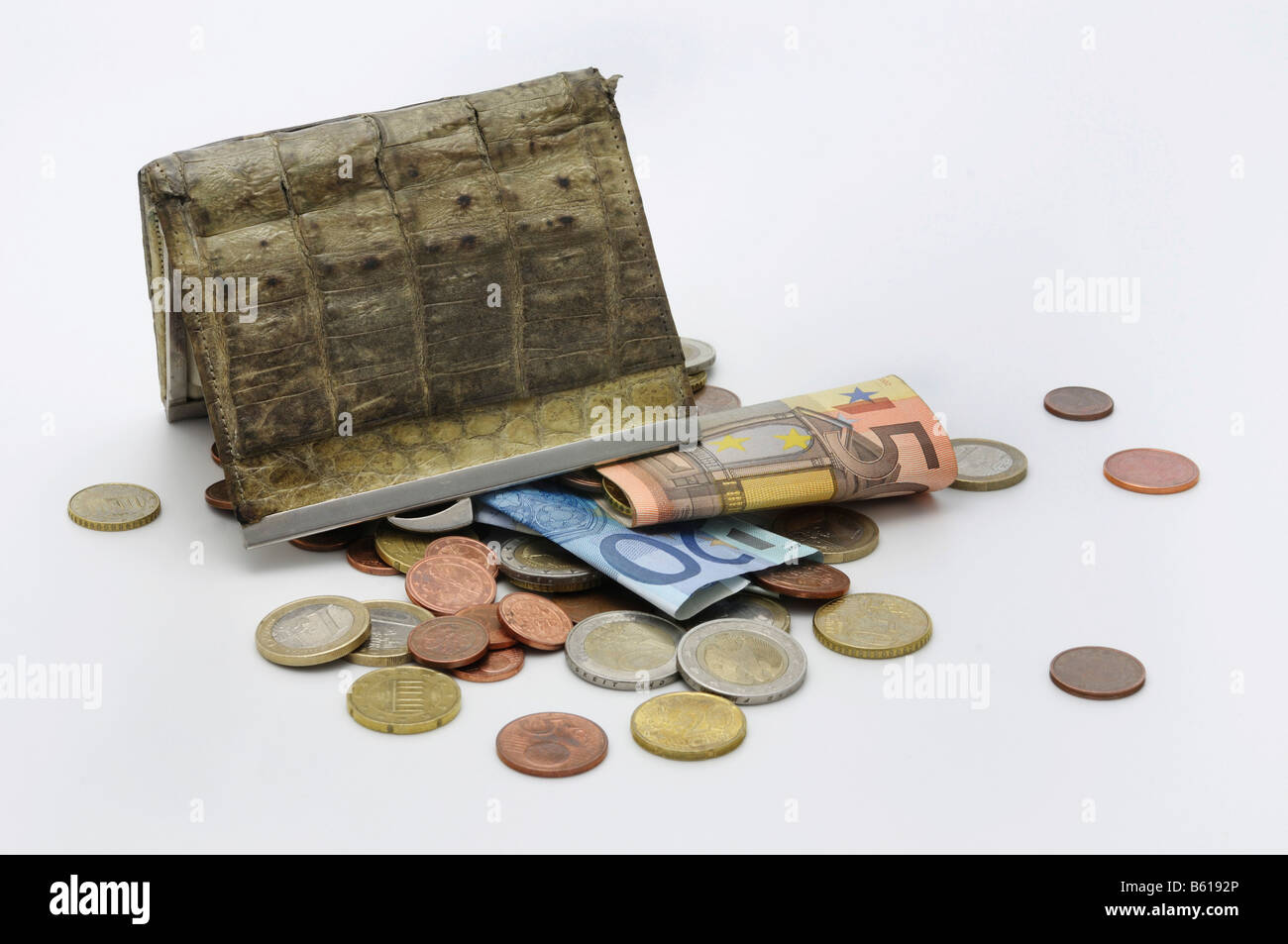 Old purse upside down, Euro bank notes and coins falling out, cash check - Stock Image