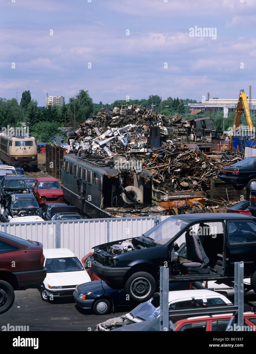 View of a scrapyard, car chassis, electric trains and old metal parts Stock Photo