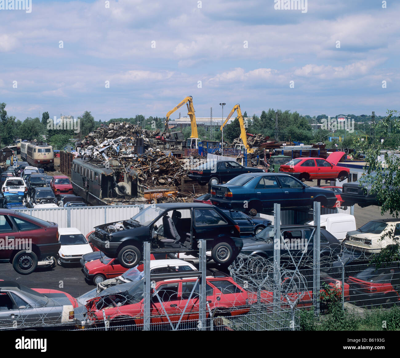 View of a scrap metal collection point, car chassis, pile of metal rubbish - Stock Image