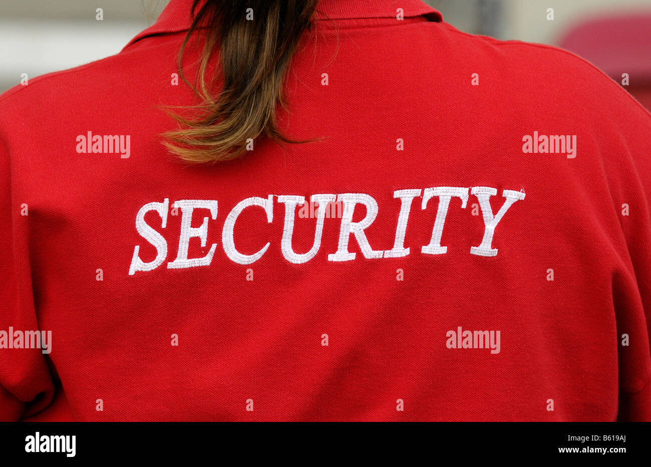 Security written on a red T-shirt - Stock Image