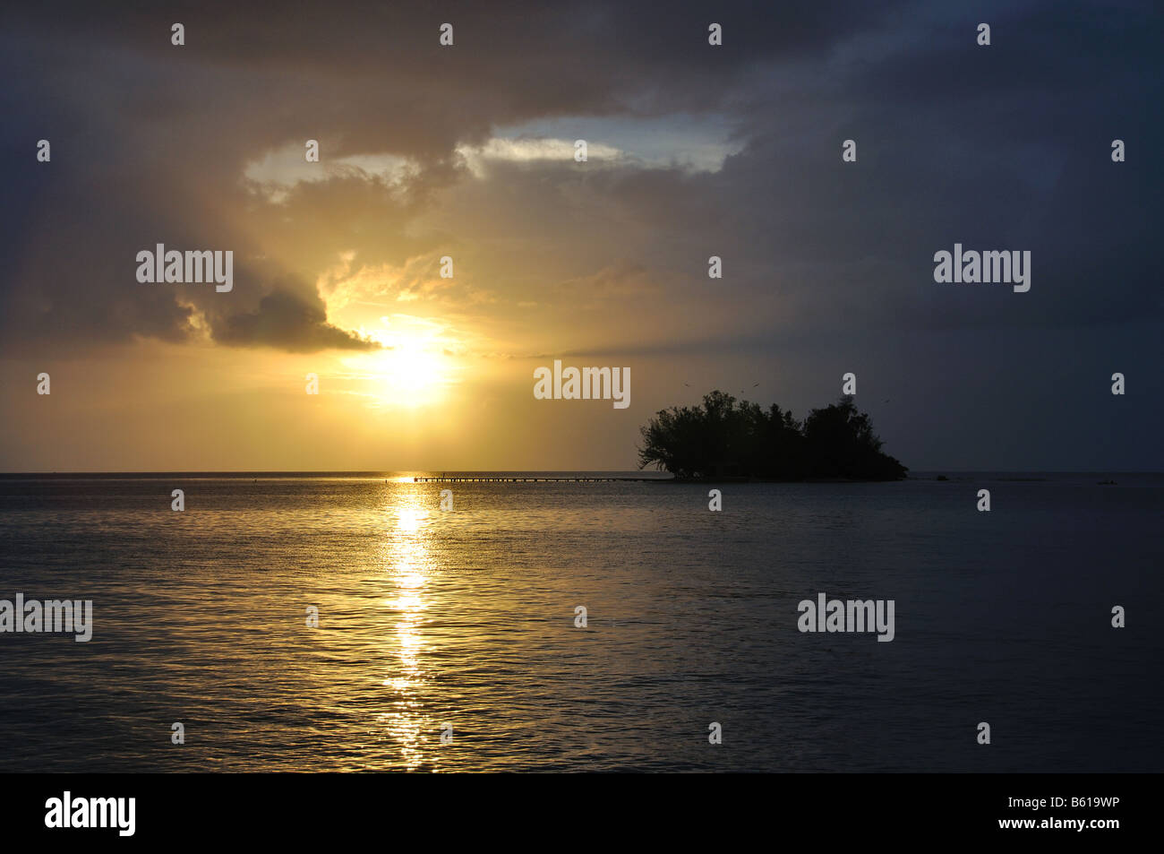 the sun sets on a small island off the west coast of puerto rico - Stock Image