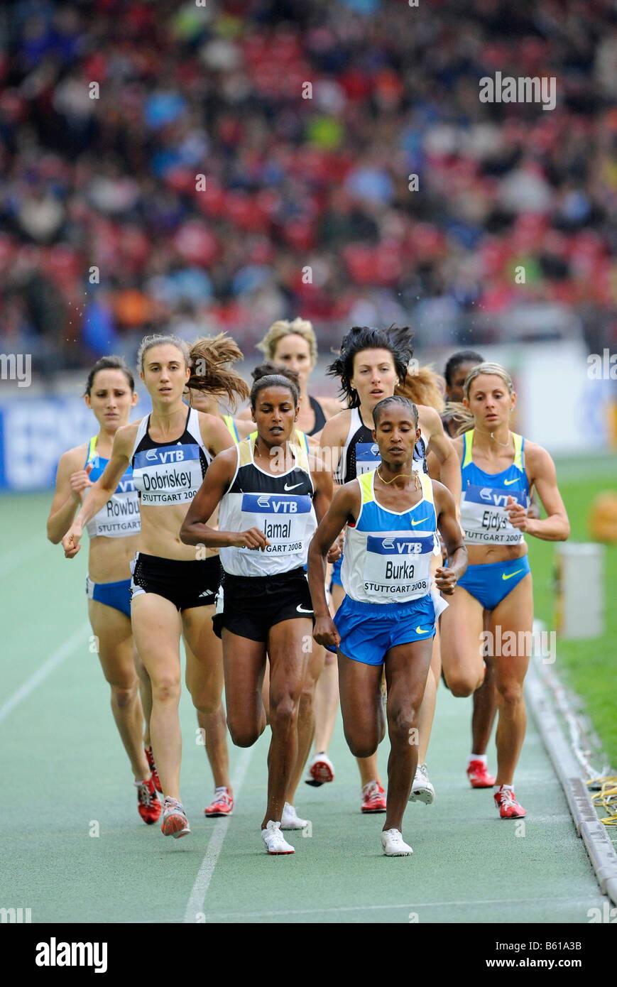 Maryam Yusuf JAMAL, BRN, winner of the 1500m, in front of Gelete BURKA, ETH, at the IAAF 2008 World Athletics Final - Stock Image