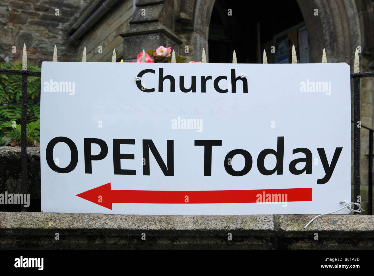 an open today sign outside a church - Stock Image
