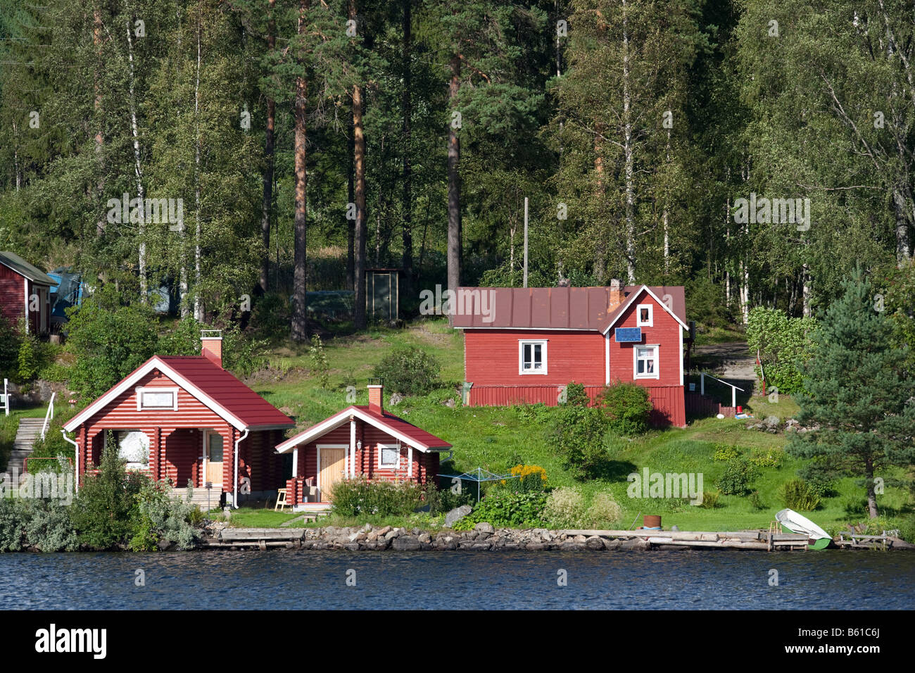 Finnish summer cottage and sauna buildings by a lake , Finland - Stock Image