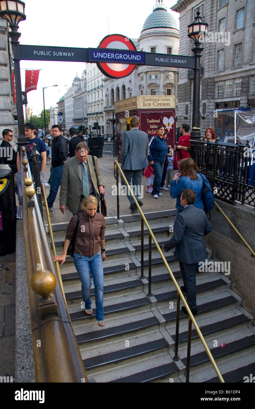 People entering and exiting the London Underground transit system in the city of London England Stock Photo