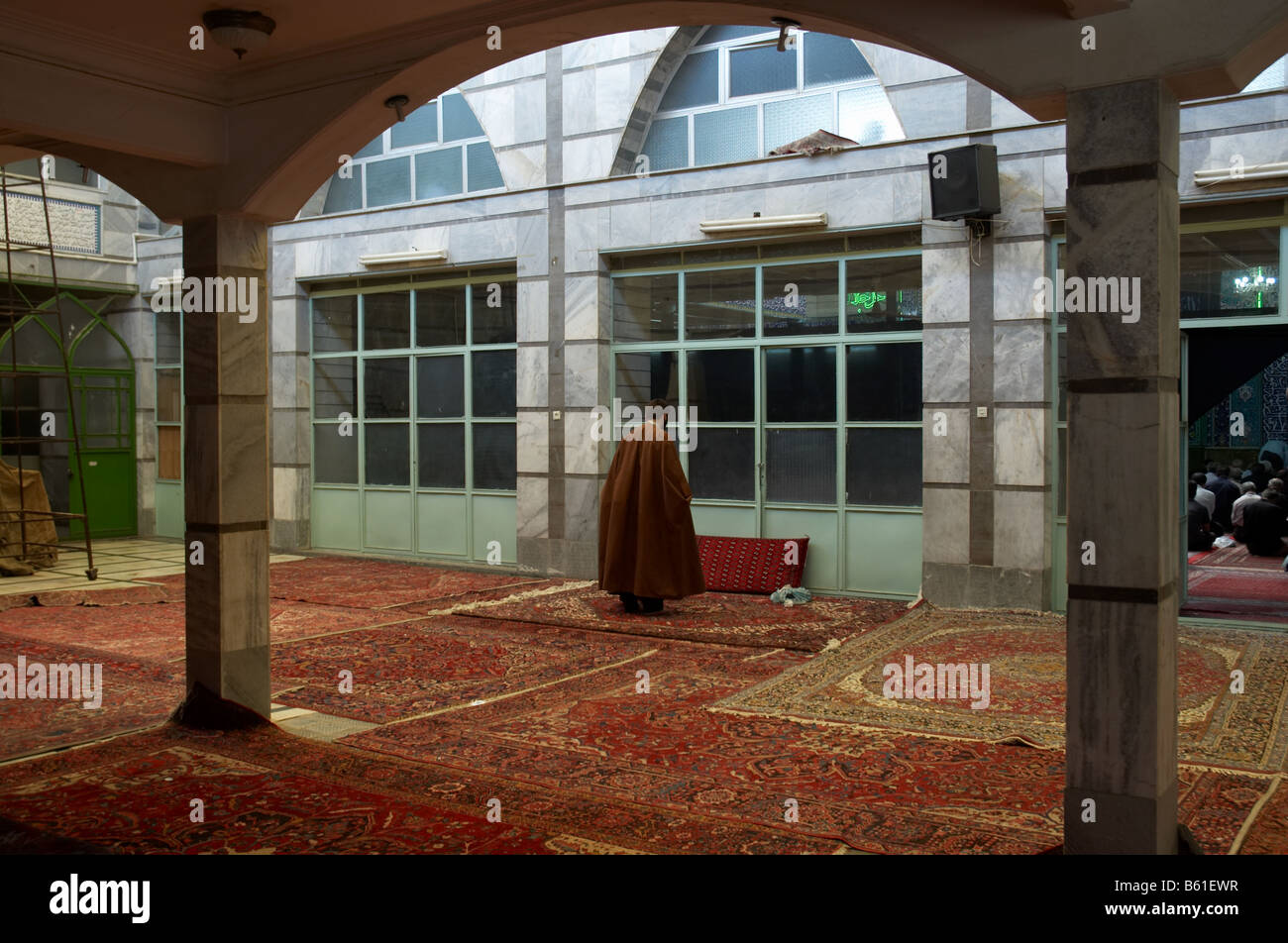 A man praying during Holy Defence Week in Seyedo Shohada mosque in Nazi Abad, down town Tehran - Stock Image