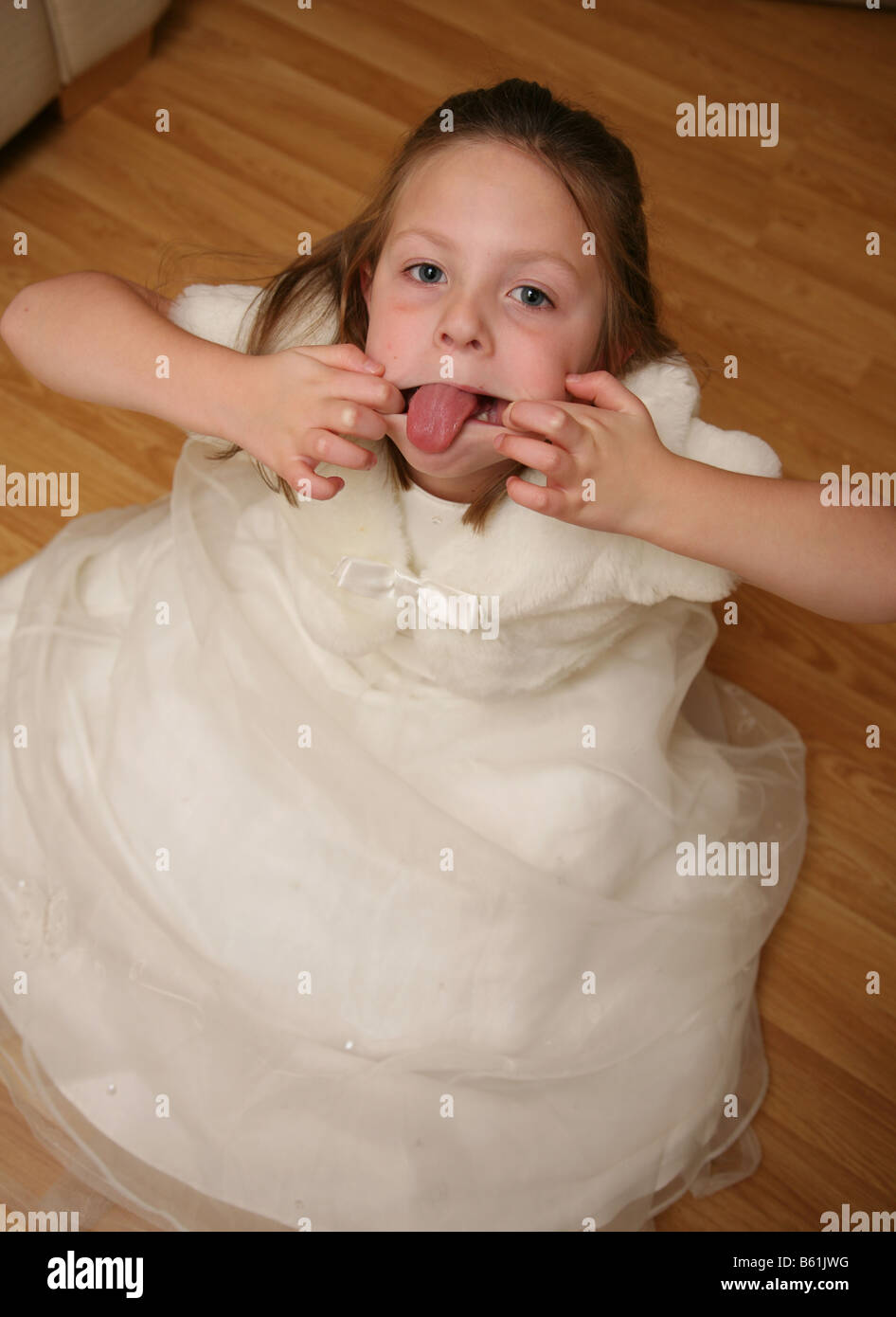 5 year old girl having a temper tantrum and poking out her tongue - Stock Image