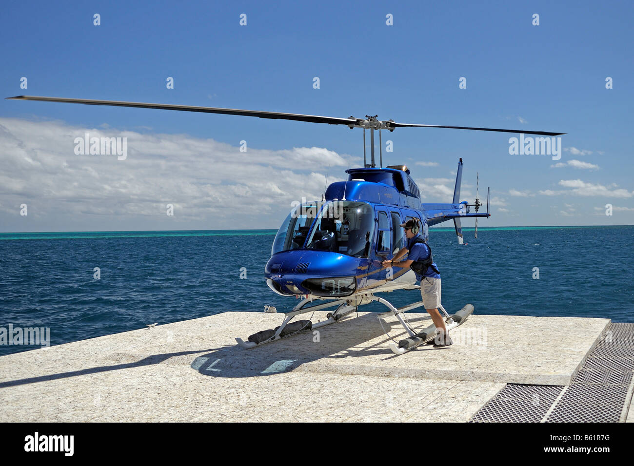 Helicopter for sightseeing flights on a pontoon in the Great Barrier Reef, Australia - Stock Image