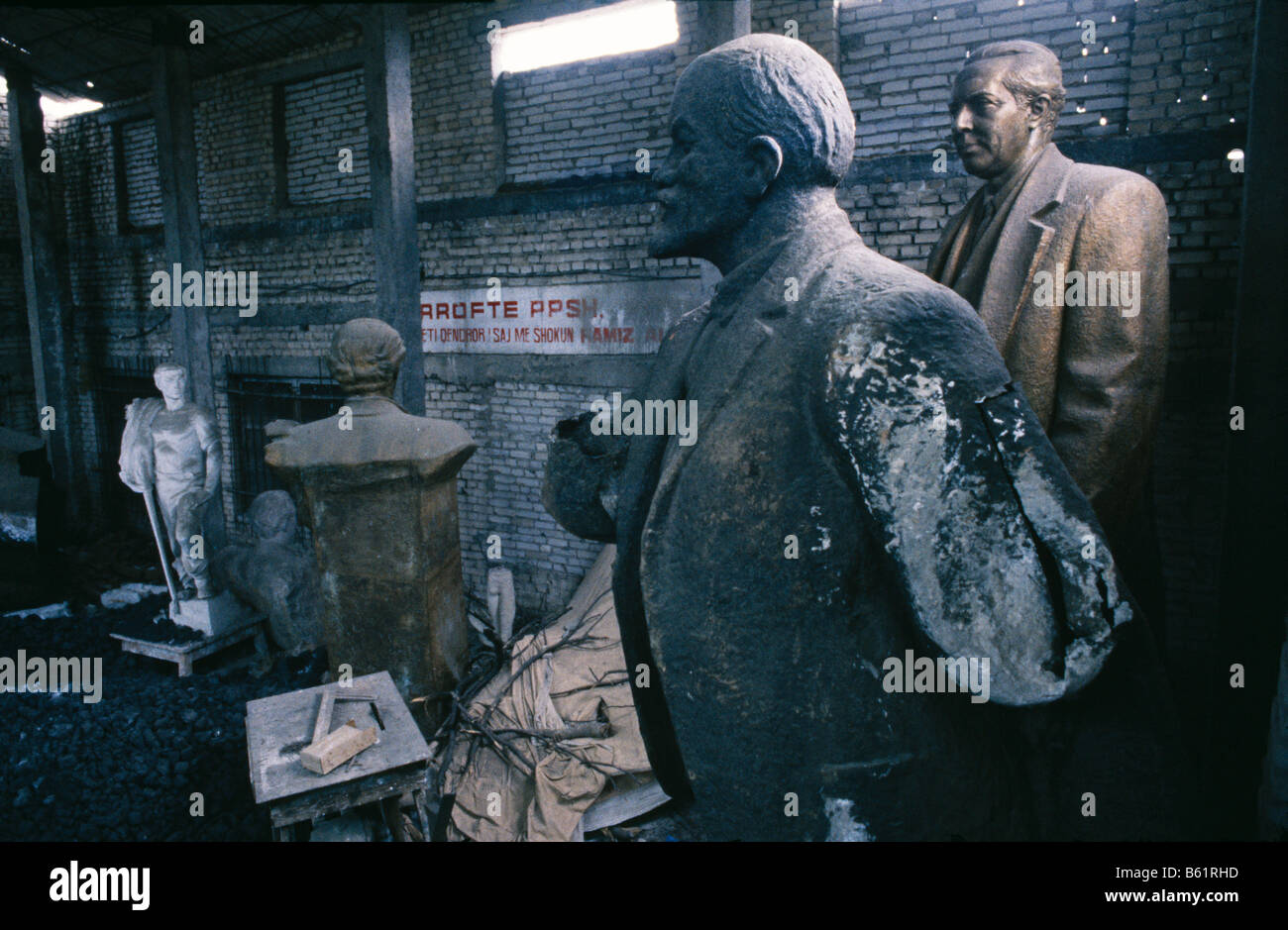 Statues of Enver Hoxha Vladimir Illych Lenin and others stand abandoned , Tirana, Albania - Stock Image