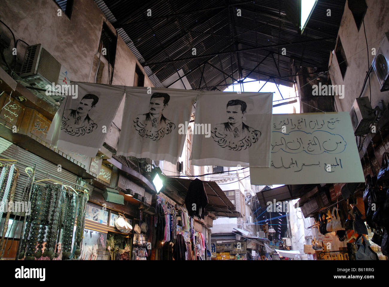 Flags with portrait of president Baschar-al-Assad in the souk in the historic city centre of Damascus, Syria, Middle - Stock Image