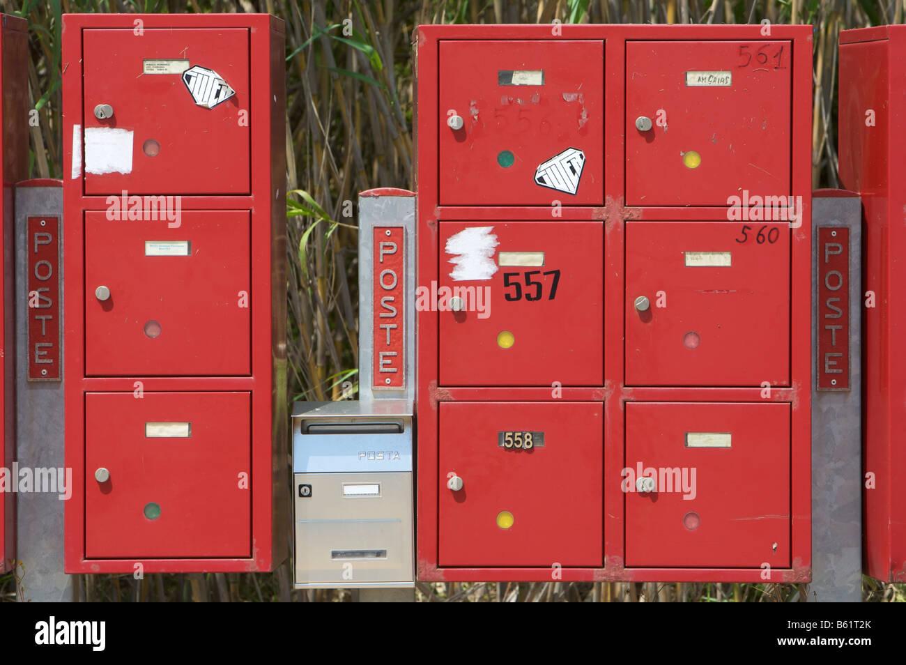 Red mailboxes on a road near Cugnana, Sardinia, Italy, Europe Stock Photo