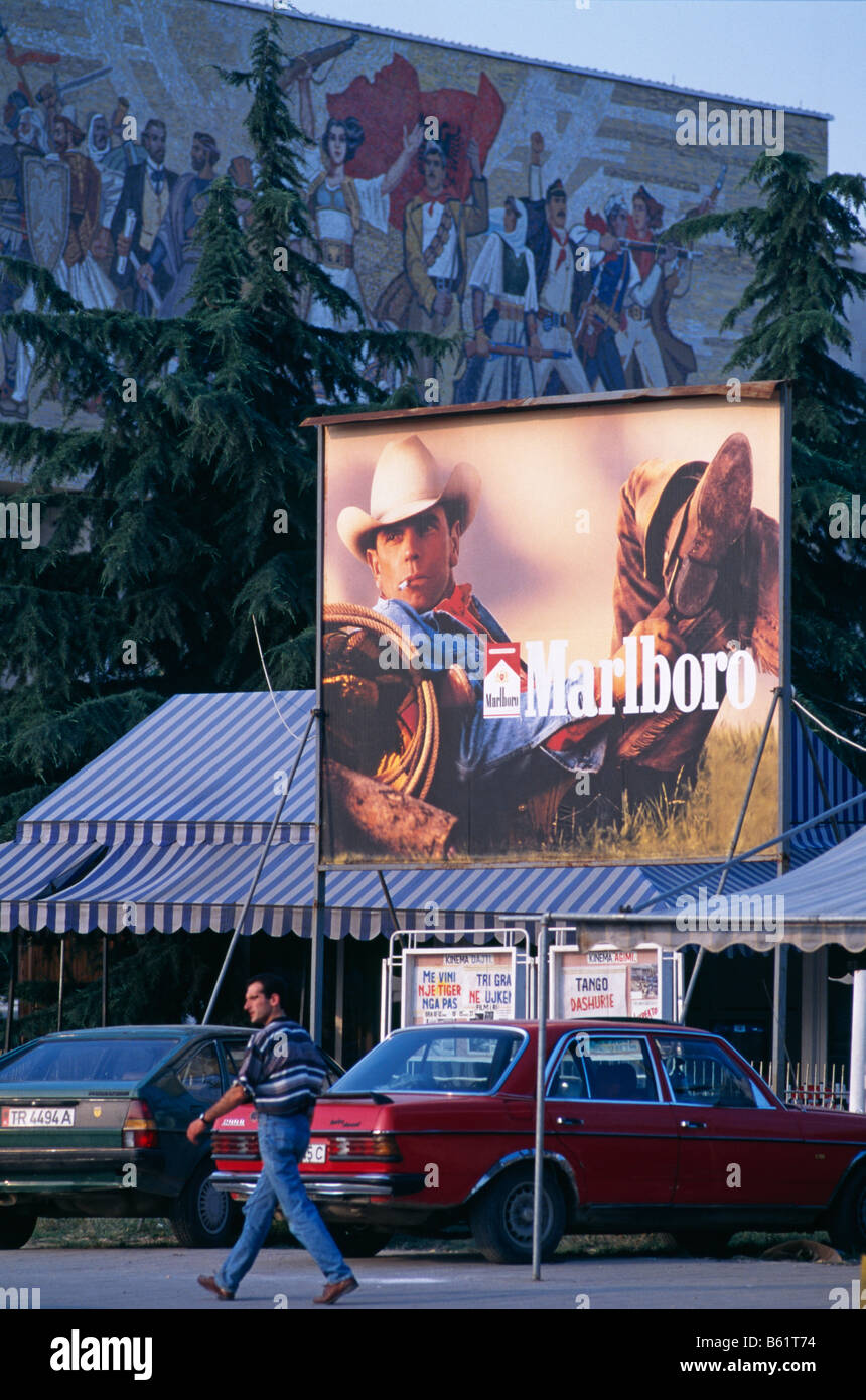 Marlboro cigarette advert billboard, and the National Museum of History (with the Albanian Victorious History mosaic - Stock Image