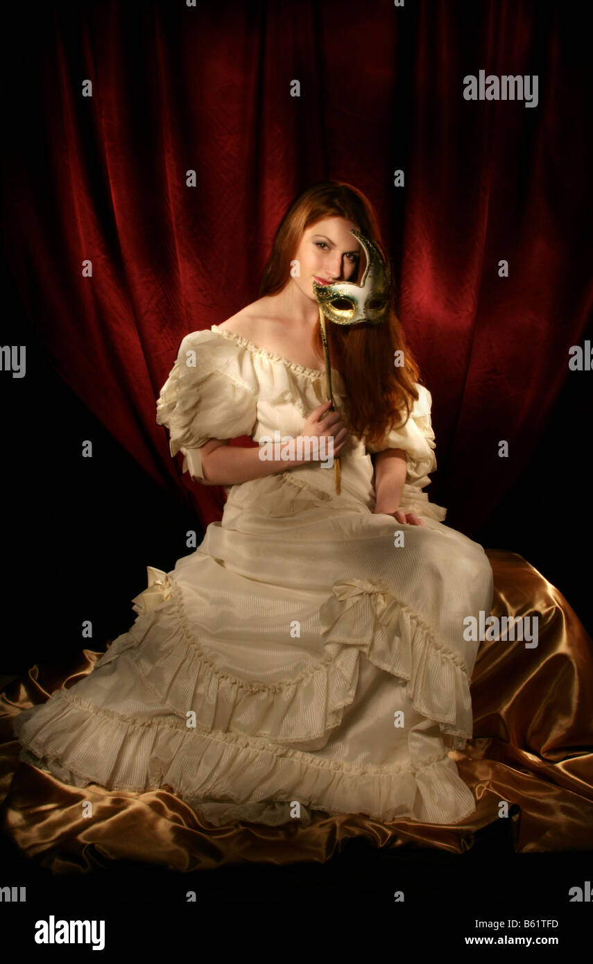 Light Painted Portrait of a Young Woman in a Ball Gown Holding a ...