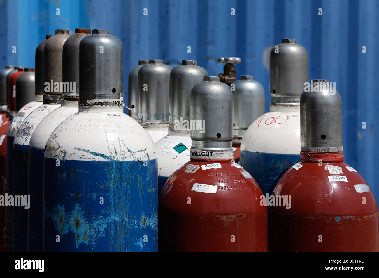Compressed gas bottles with oxygen and acetylene for gas welding, detail, building site, Krefeld-Uerdingen, North - Stock Image
