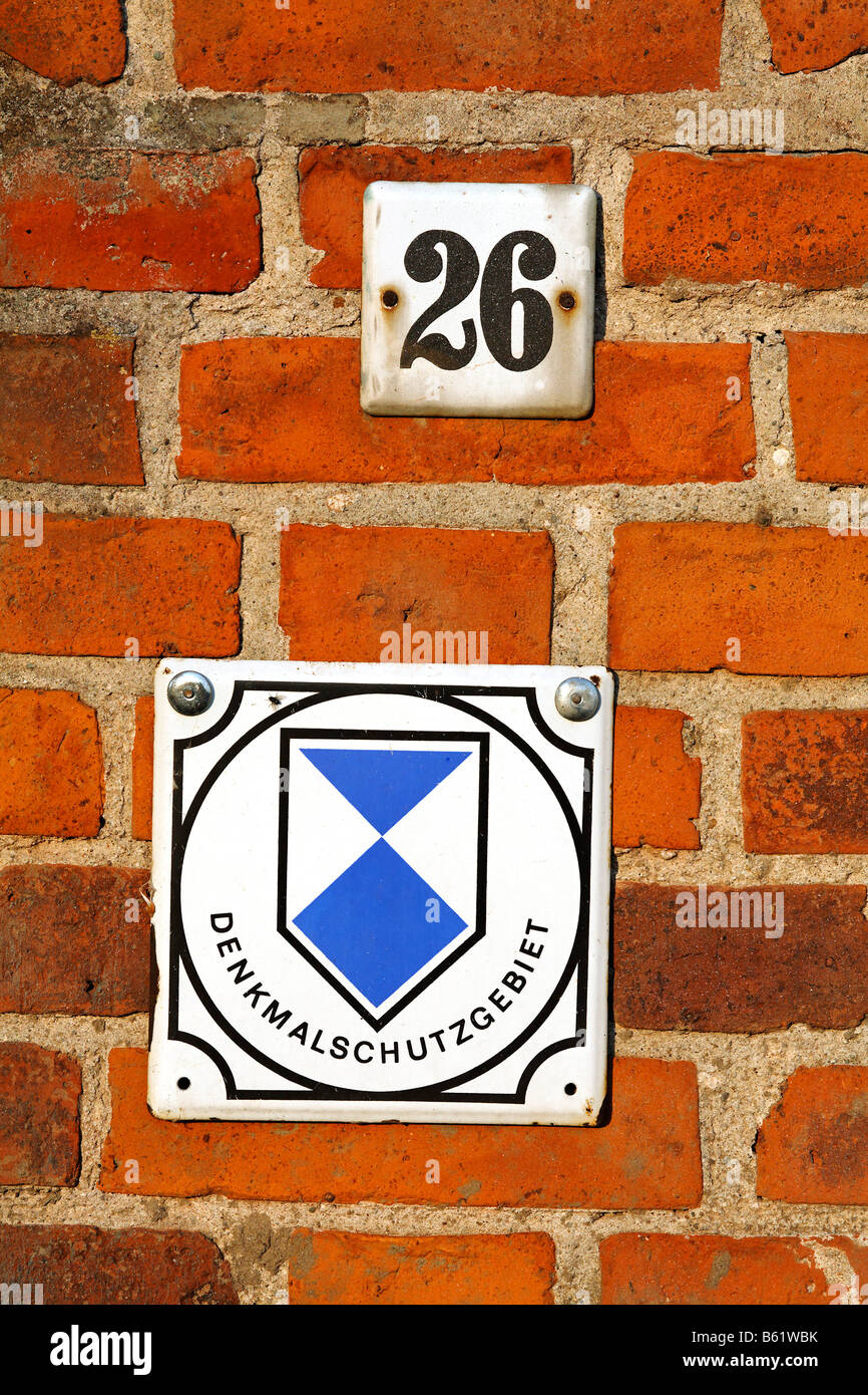 Sign, protected monument and house number on a brick wall, Oderbruch region, Maerkisch-Oderland district, Brandenburg, - Stock Image