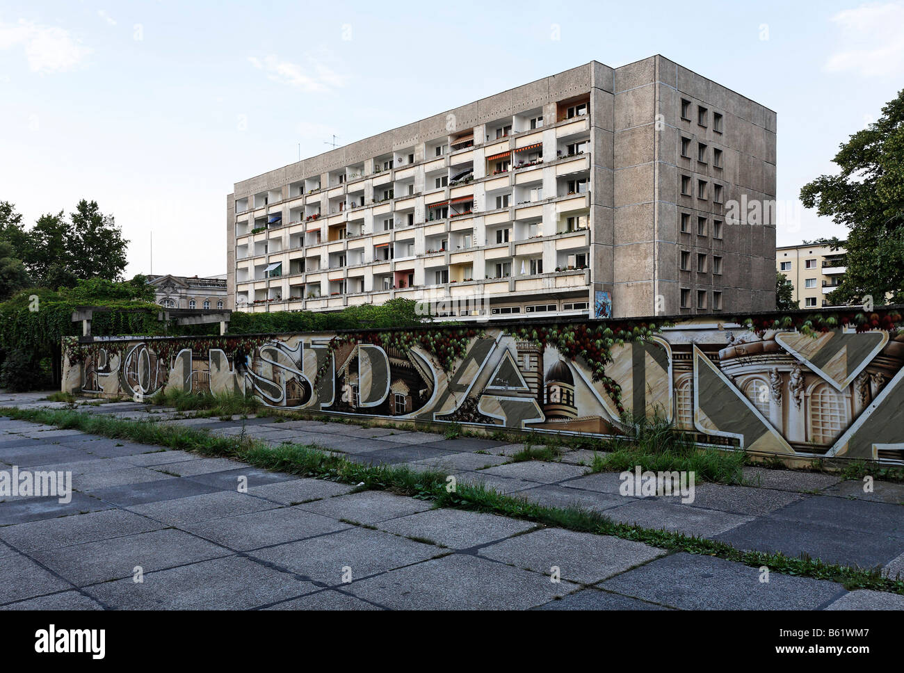 Depressing pre-fabricated building from DDR times, wall with graffiti writing Potsdam, inner city, Brandenburg, - Stock Image