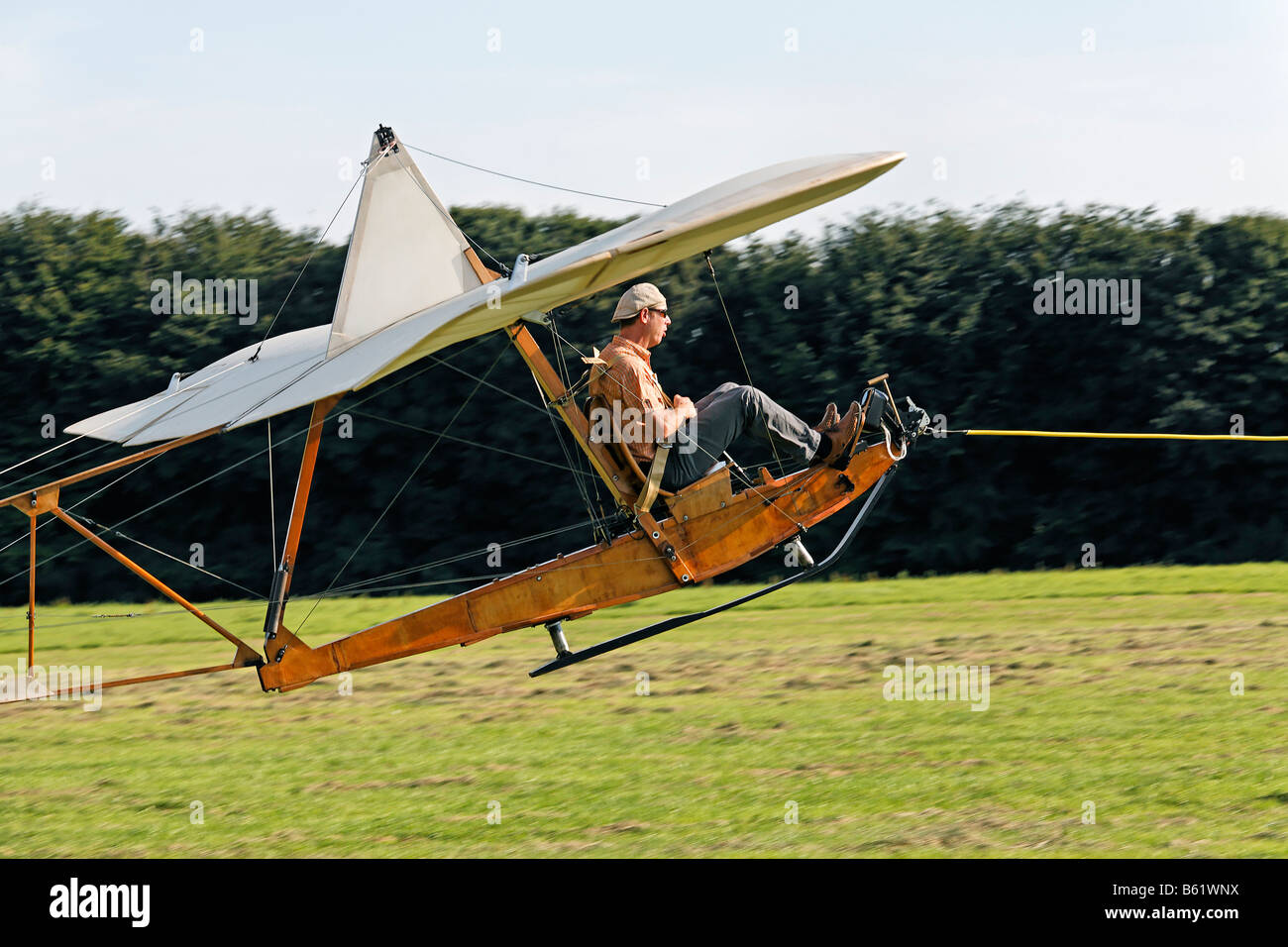 Historic glider SG38 being pulled on a cable into the air, wooden construction with an open seat, glider to train - Stock Image