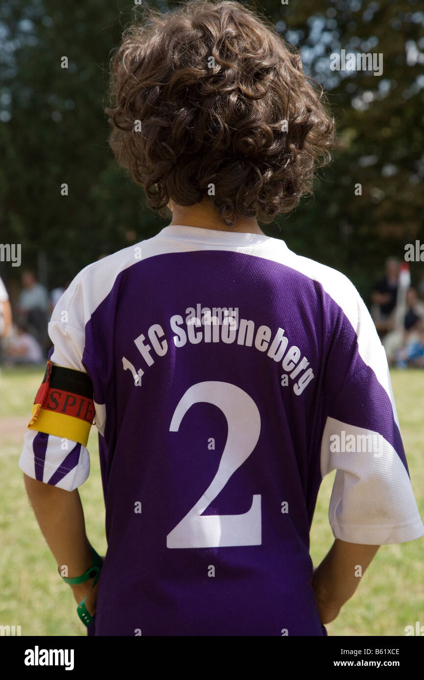 Young football player from behind, team captain band, tricot number 2, 1. FC Schoeneberg, Berlin, Germany, Europe - Stock Image