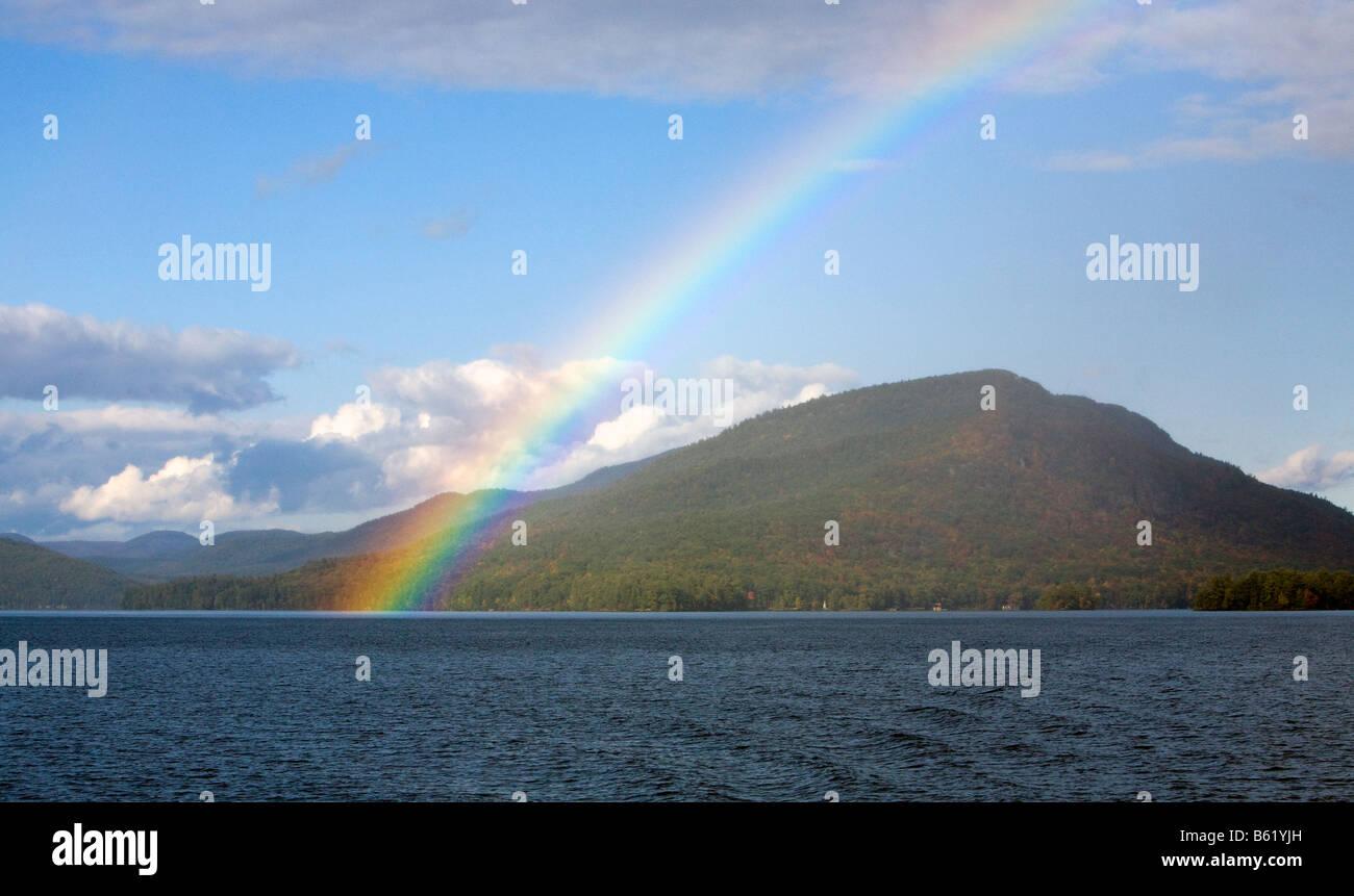 A beautiful rainbow shot at on the lake at Lake George New York. - Stock Image