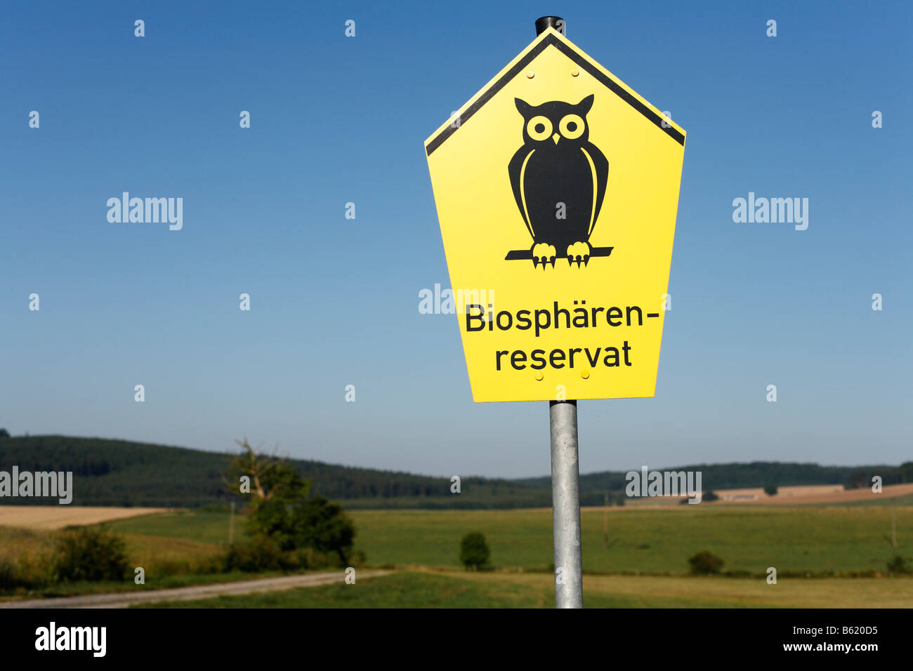 Yellow sign with a icon of a Owl designating a Biosphaerenreservat or Biosphere Reserver, Rhoen, Thuringia, Germany, - Stock Image