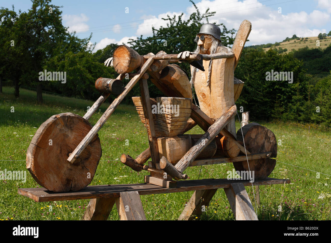 Chopper motorbike, artwork made out of wood, in the woodcarving town of Empfertshausen, Rhoen, Thuringia, Germany, - Stock Image