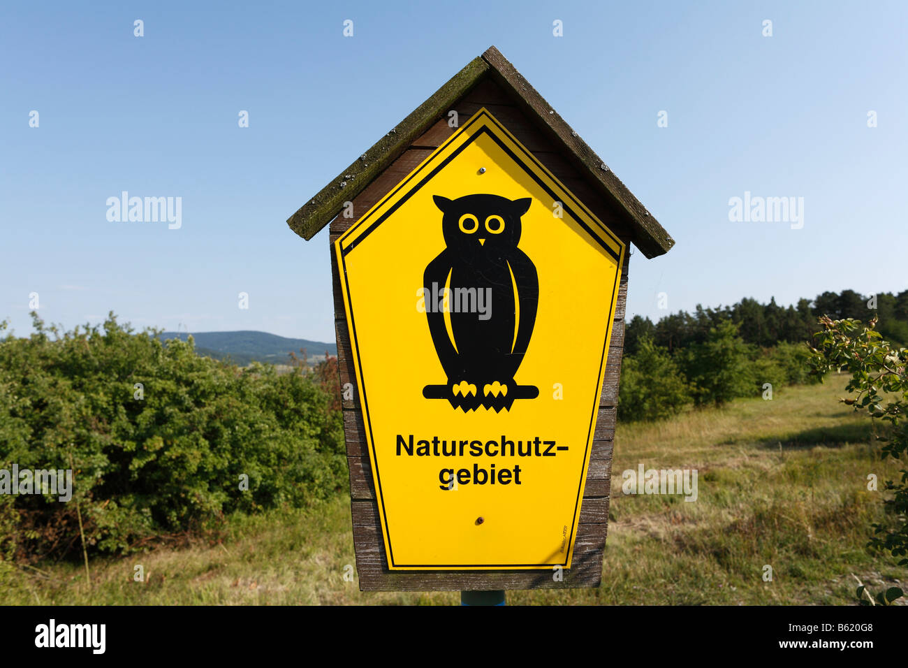 Yellow sign with owl, 'conservation area', Rhoen, Thuringian border strip, Germany, Europe - Stock Image