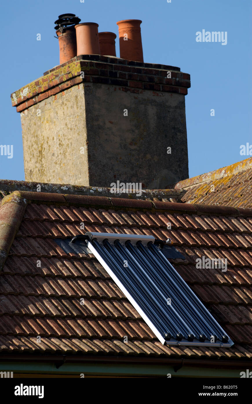 Solar evacuated tubes to heat the water of a house in Bawdsey, Suffolk, UK. - Stock Image