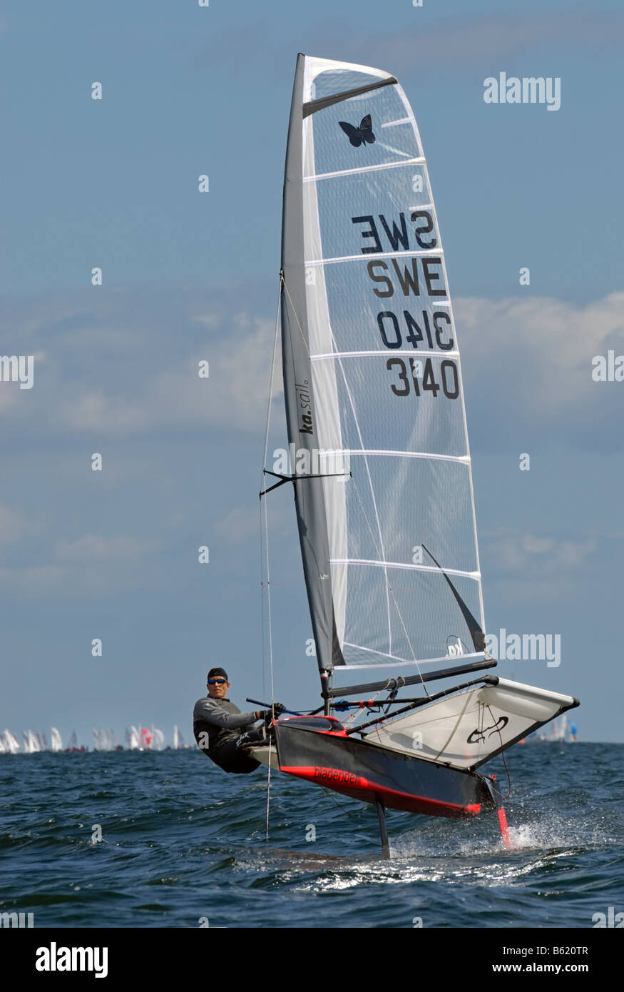Sailor competing in the regatta for the sailing boat category, International Moth Class, Schilksee, Kiel Week 2008, - Stock Image