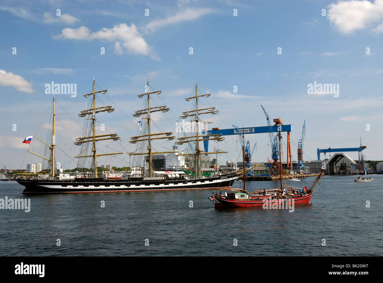 Russian Tall Ship, Kruzenshtern, and other tall ships in front of the crane of the Howaldtswerke-Deutsche Werft, Stock Photo