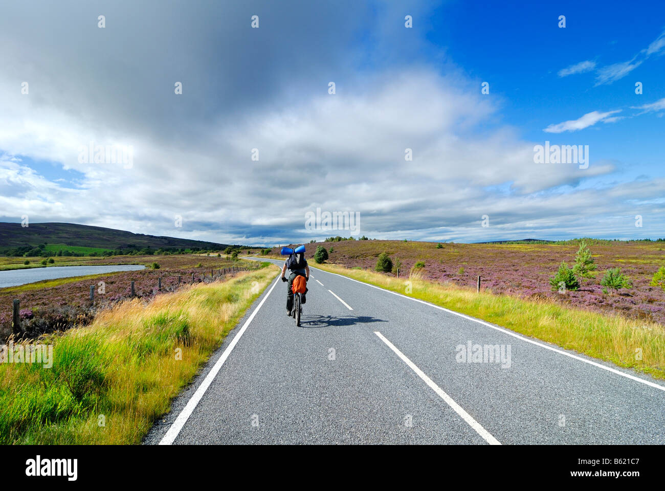 Cyclist in the Grampian Mountains, Scotland, Great Britain, Europe - Stock Image