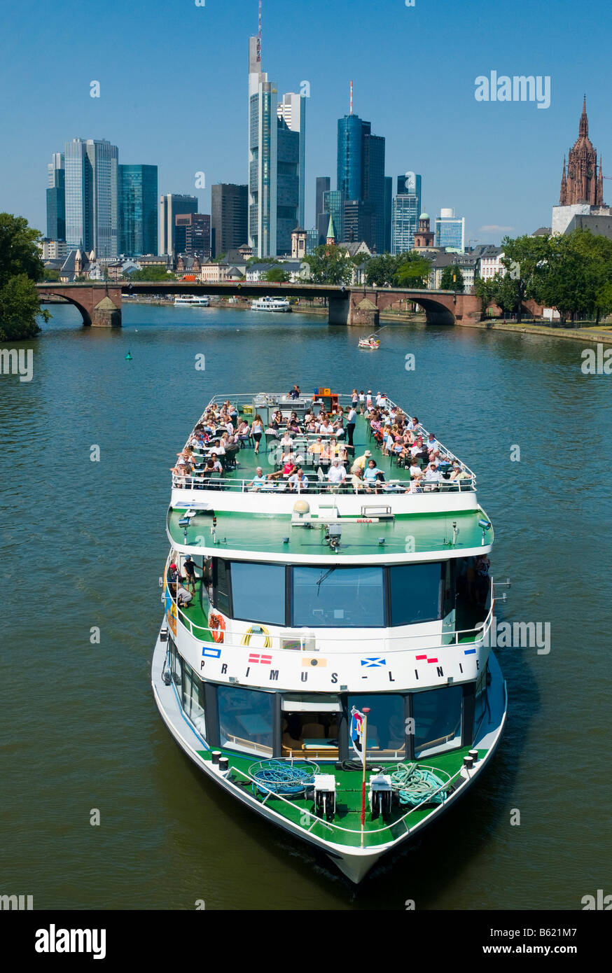 Tourist ship on the Main River, skyline of Frankfurt, Hesse, Germany, Europe - Stock Image