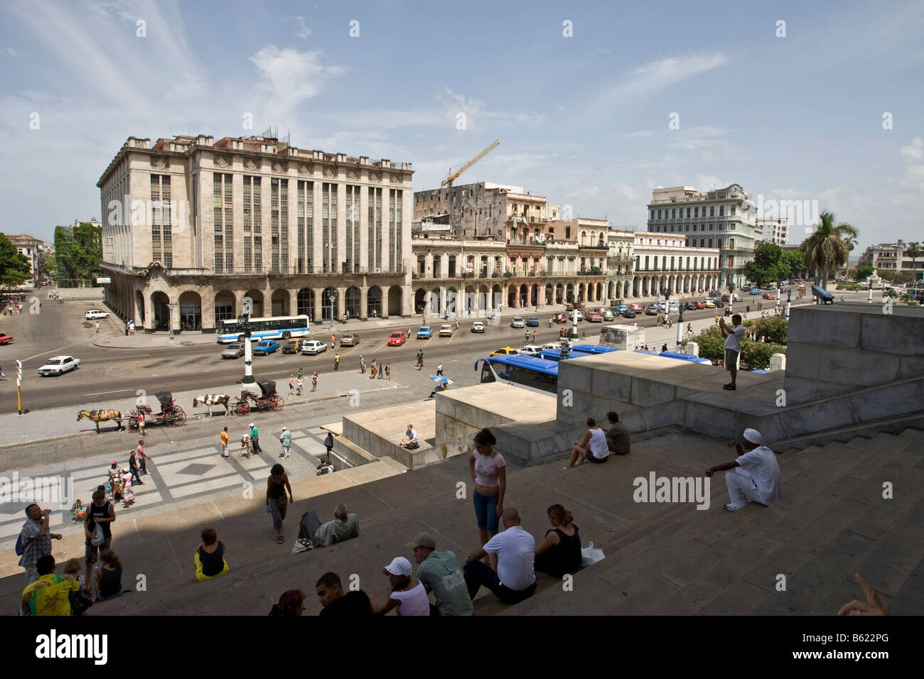 Cubans sitting on the stairs leading to the Capitol, Parque Central on the Boulevard Paseo de Marti, square by the Stock Photo