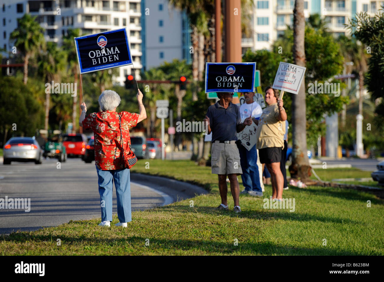 Supporters show signs for Barack Obama for President on busy road - Stock Image