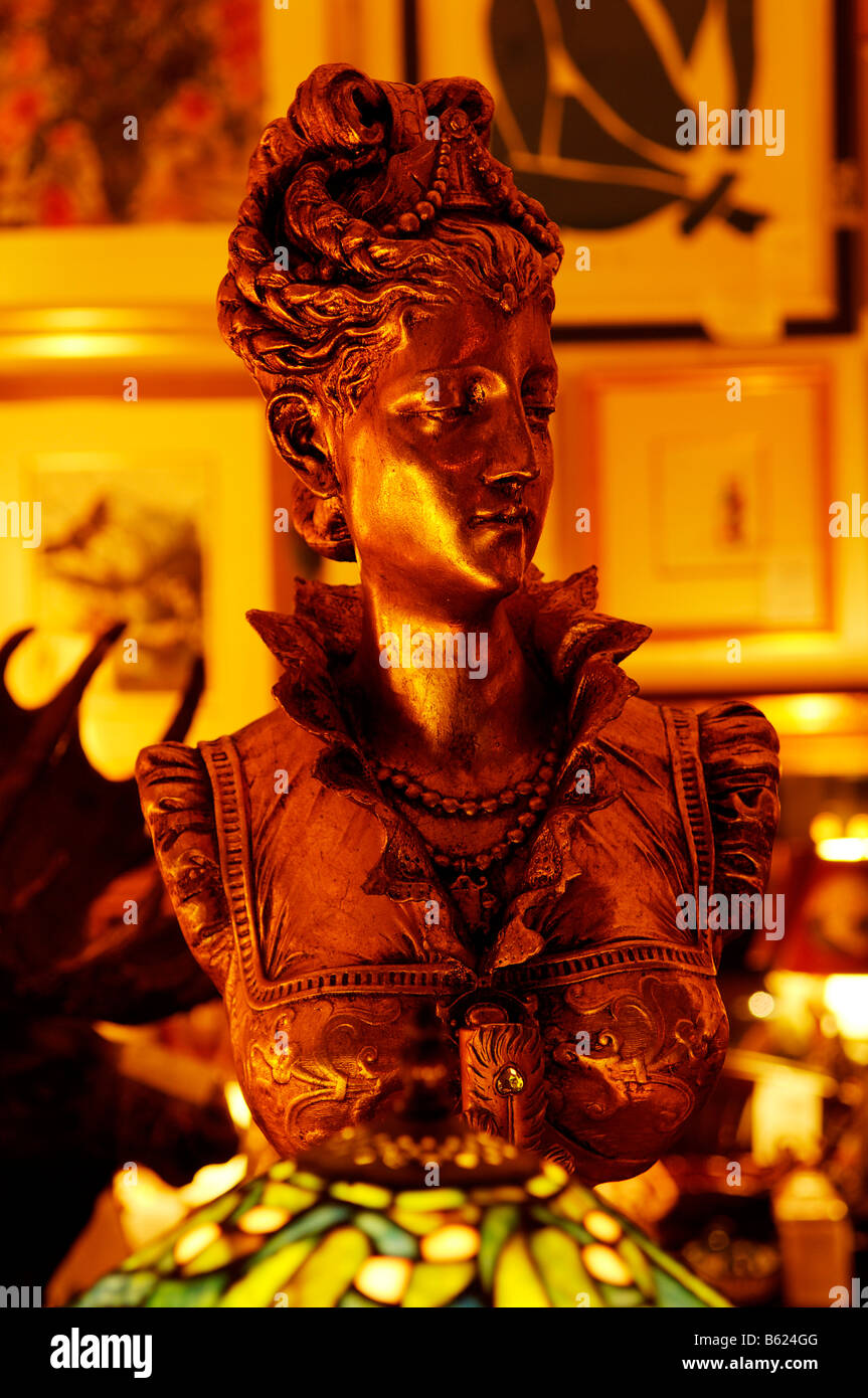 Gold-plated bust of a woman in a gallery in Berlin, Germany, Europe - Stock Image
