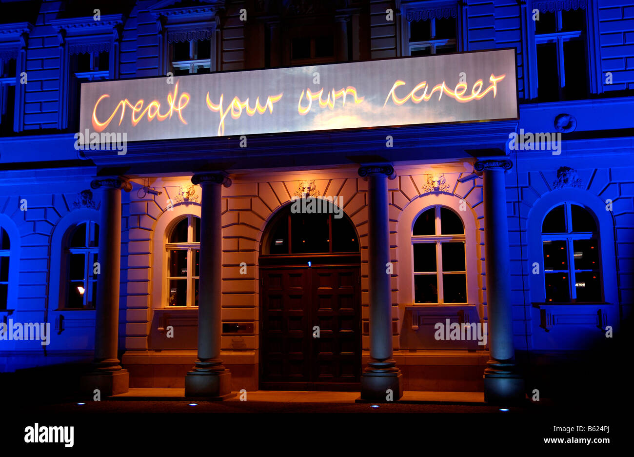 Sign, Create Your Own Career, night lit advertising on a building facade in Berlin, Germany, Europe - Stock Image