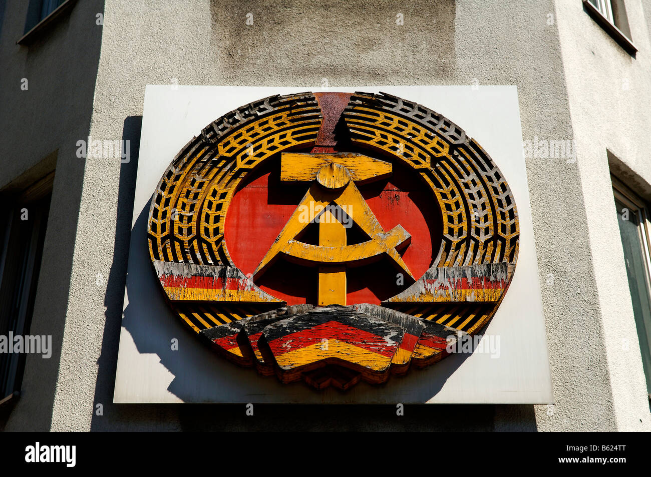Sign, hammer and sickle, on Checkpoint Charlie, Berlin, Germany, Europe - Stock Image