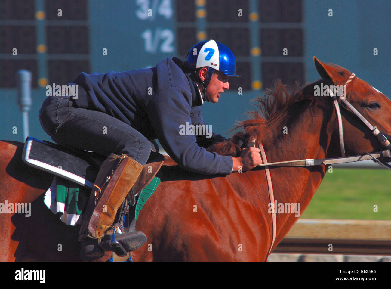 Horse racing jockey on a horse racing on an American race track Stock Photo