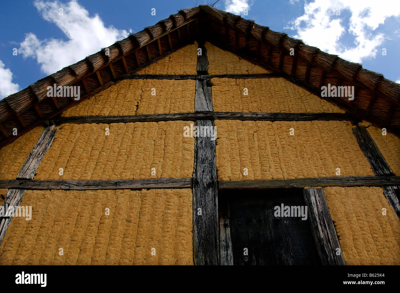 Ancient facade of a wattle and daub half-timbered house with thatched roof 1561, eco-museum, Ungersheim, Alsace, - Stock Image