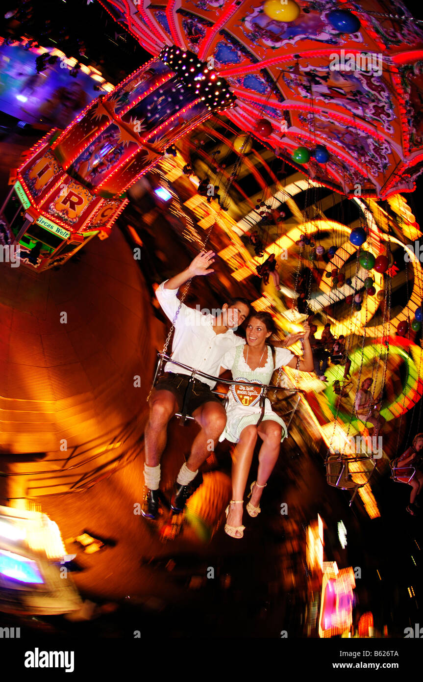 Oktoberfest Beer Festival, Wies'n, couple on the chairoplane, Munich, Bavaria, Germany, Europe Stock Photo