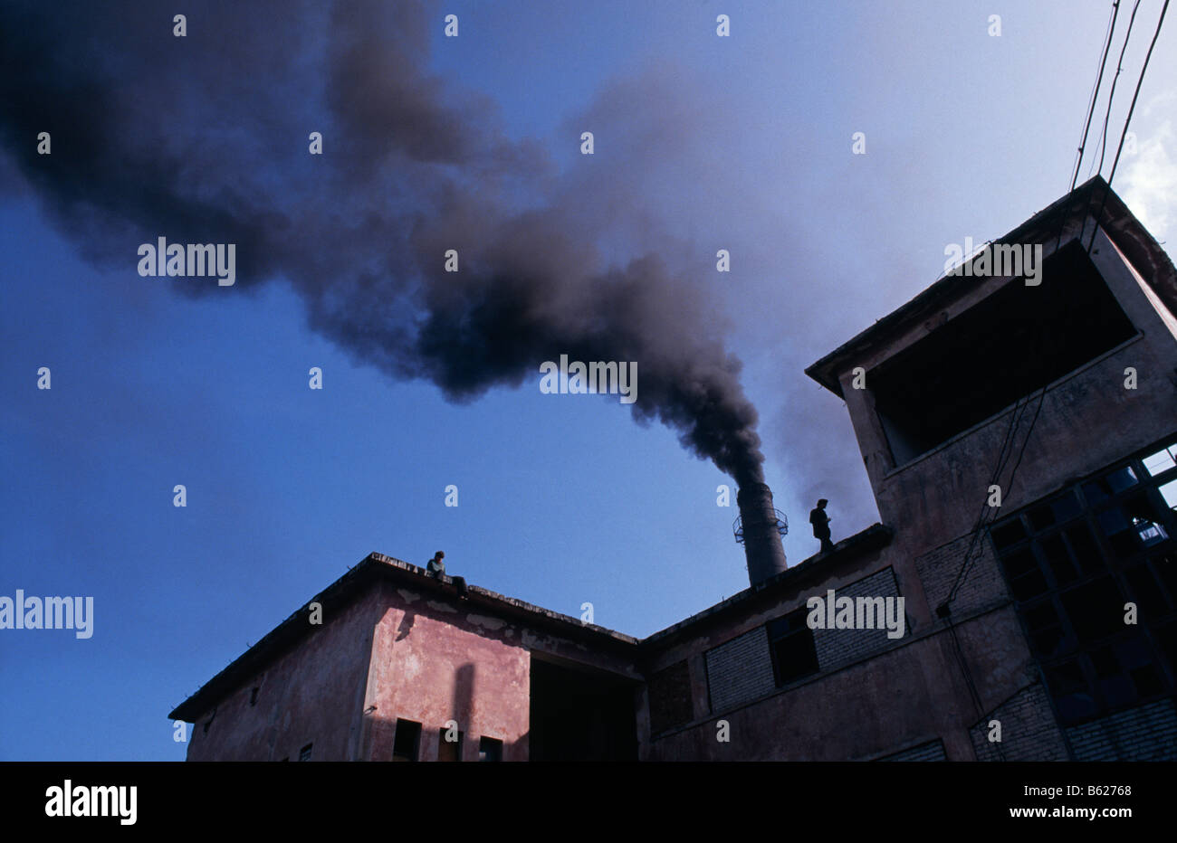 Factory belching smoke,  Albania 1994 - Stock Image