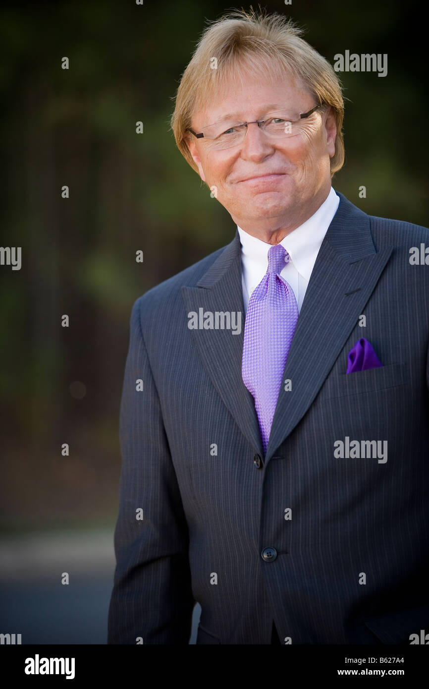 Blonde man wearing business suit stock photos blonde man wearing 50 year old business man standing outside wearing a suit and tie smiling and publicscrutiny Images
