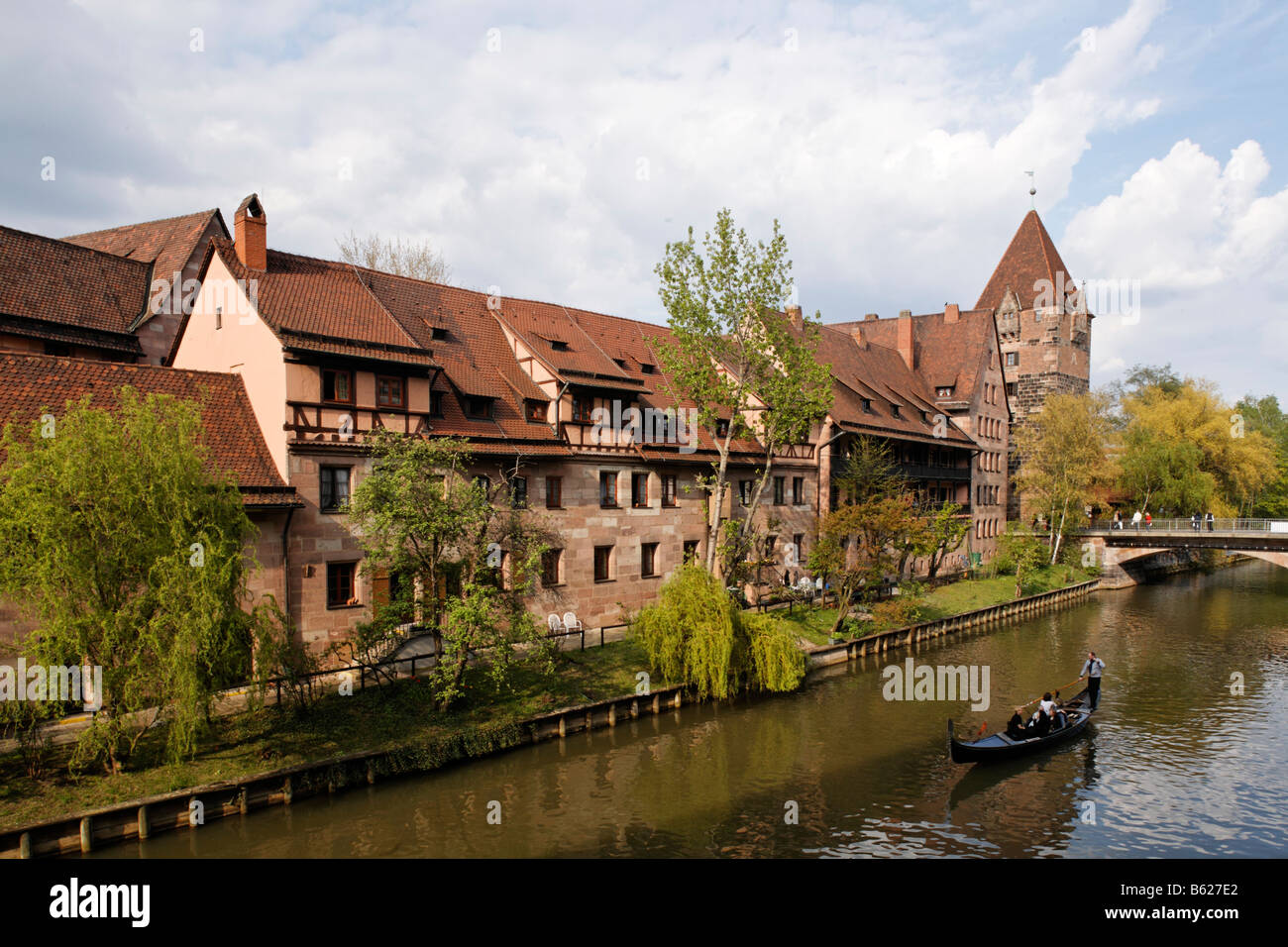 The bank of the river Pegnitz, Venetian gondola, Heubruecke Bridge, Schuldturm Tower, Nuremberg, Middle Franconia, - Stock Image