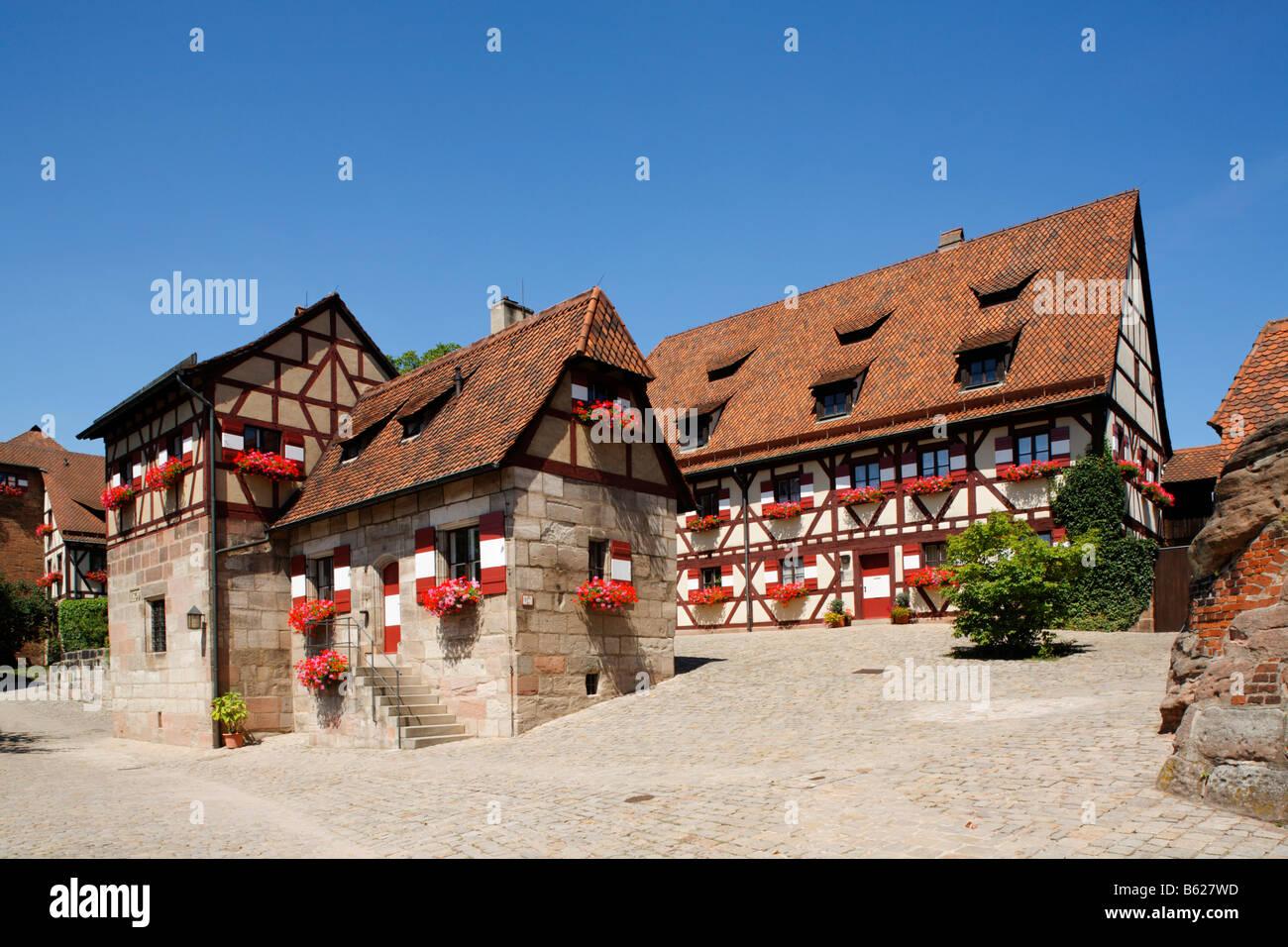 Nuremberg Castle or Kaiserburg, fore-court, half-timbered houses, Nuremberg, Middle Franconia, Bavaria, Germany, - Stock Image