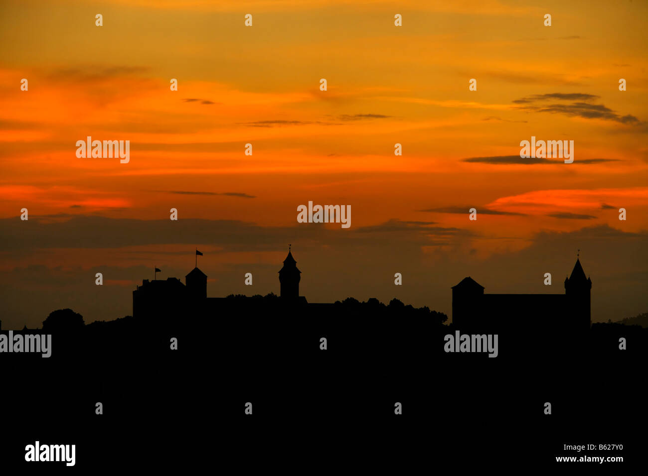 Red evening sky with the silhouette of Nuremberg Castle, Nuremberg, Middle Franconia, Bavaria, Germany, Europe Stock Photo
