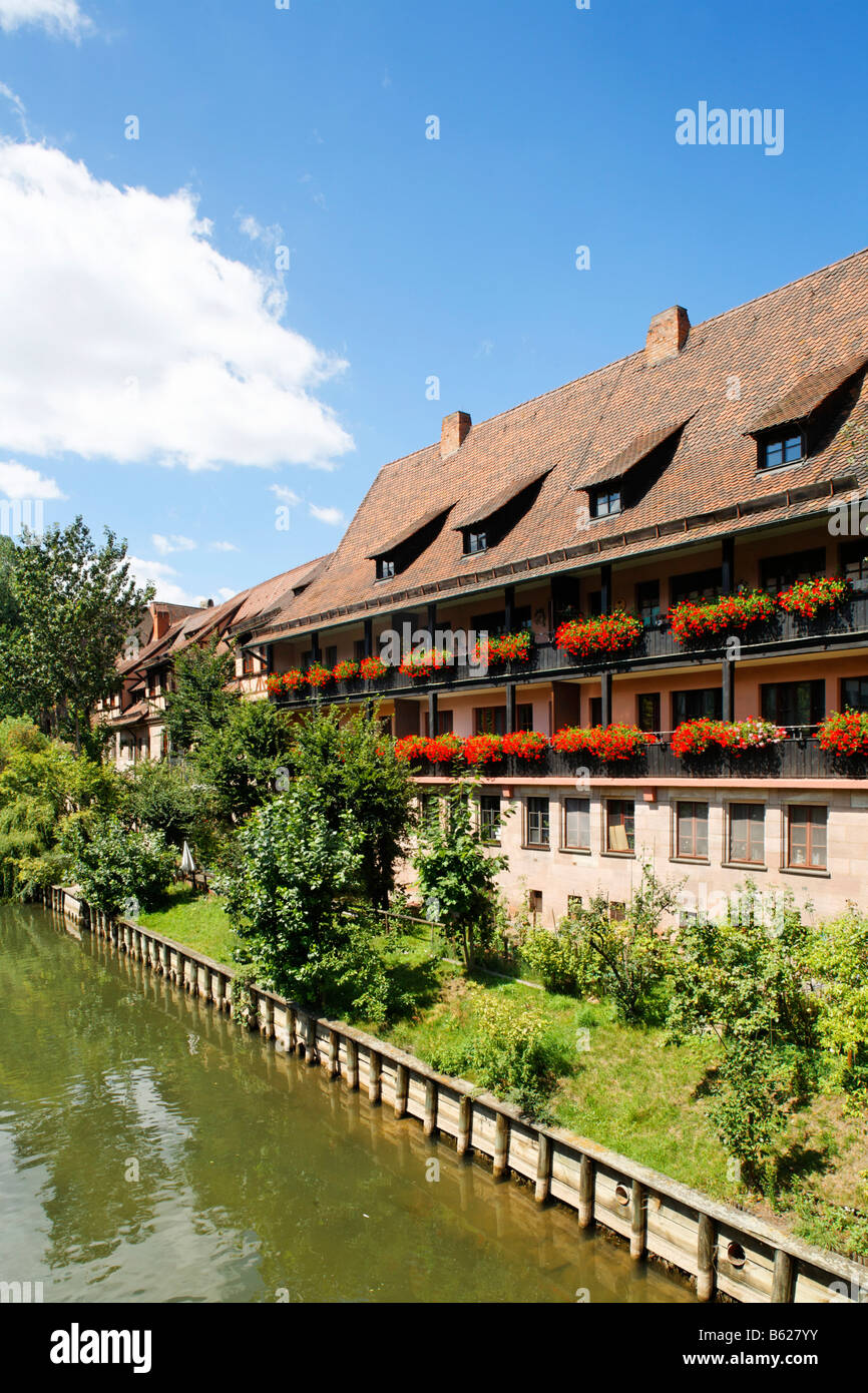 Pegnitz River, house decorated with flowers in the Heilig Geist Spital, historic city centre, Nuremberg, Middle - Stock Image
