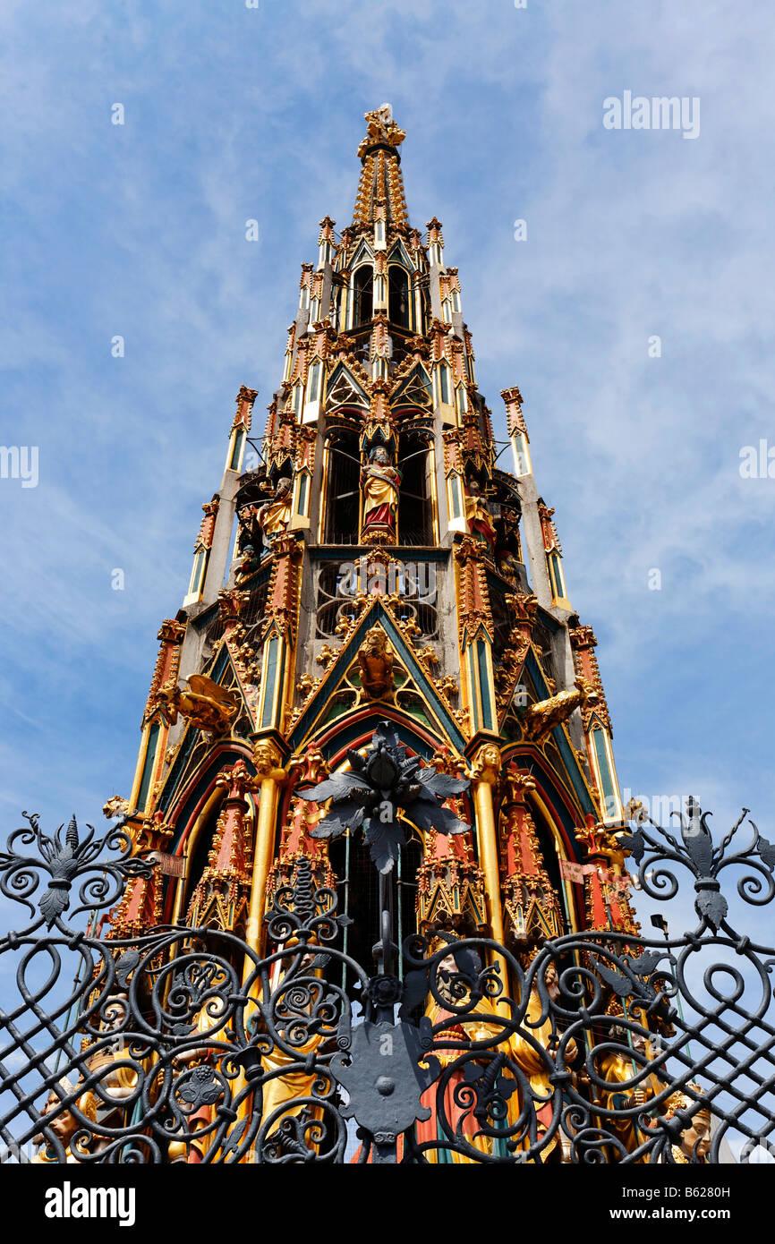 Schoener Brunnen Fountain, shaped like a gothic church spire, cast iron railings, main market, historic city centre, - Stock Image