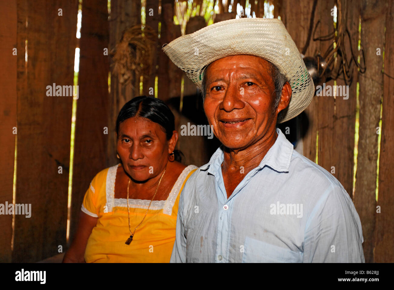 Married couple, sad-looking Mayan woman, proud smiling man, straw hat, residents, Punta Gorda, Belize, Central America Stock Photo